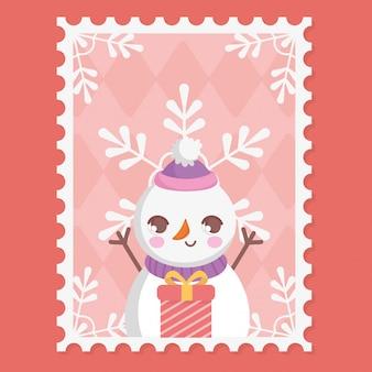 Sneeuwpop, geschenkdoos en sneeuwvlokken vrolijk kerstzegel