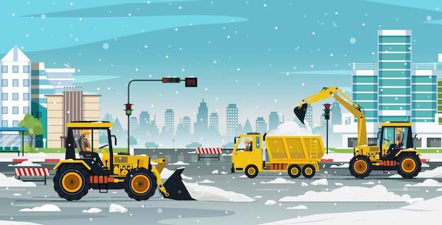 Sneeuwruimers zijn bezig om auto's op de weg te laten komen.