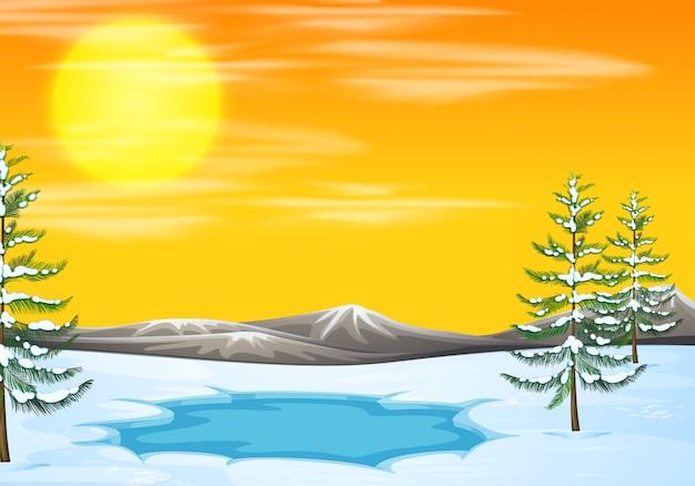 Sneeuwscène bij zonsondergang