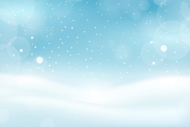 Sneeuwval met bokeh achtergrond