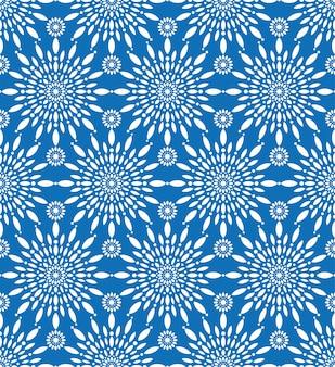 Sneeuwvlok winter koud seizoen vector patroon. naadloze textuur met mandala-sneeuwmotieven