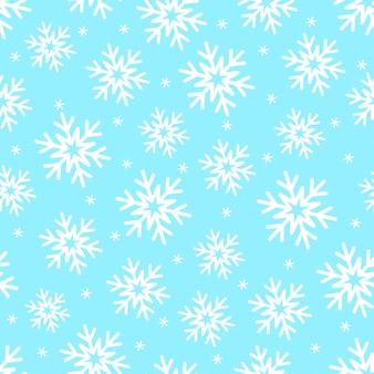 Sneeuwvlokken op blauw naadloos patroon