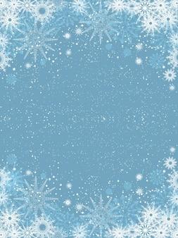 Sneeuwvlokken op lichtblauwe achtergrond