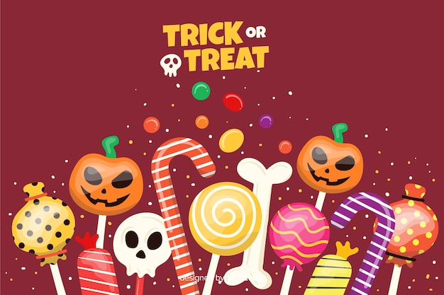 Snoepjes op platte halloween-achtergrond