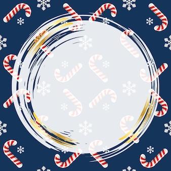 Snoepstokken en kerstsneeuwvlokken op een blauwe achtergrond sjabloon voor het maken van een ontwerpkader