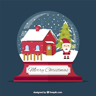 Snowglobe met de kerstman en het huis