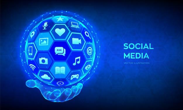 Social media globaal verbindingsconcept. abstracte 3d-bol of wereldbol met oppervlak van zeshoeken met een verschillende social media iconen in draadframe hand.