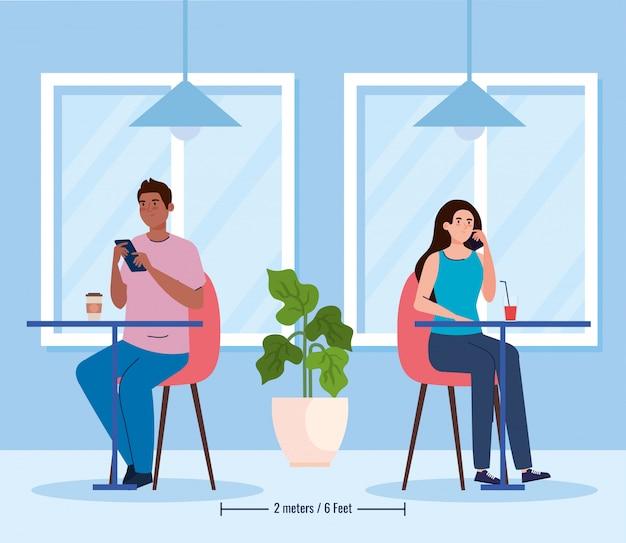 Sociale afstand in nieuw conceptrestaurant, paar dat op tafels eet, bescherming, preventie van coronavirus covid 19