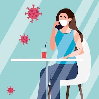 Sociale afstand in nieuw conceptrestaurant, vrouw op tafel, bescherming, preventie van coronavirus covid 19