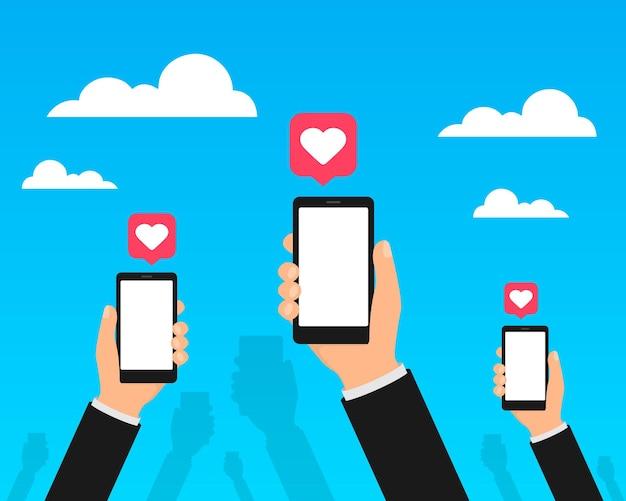 Sociale media op mobiele telefoons vector. handen houdt smartphones vast met sociale media.
