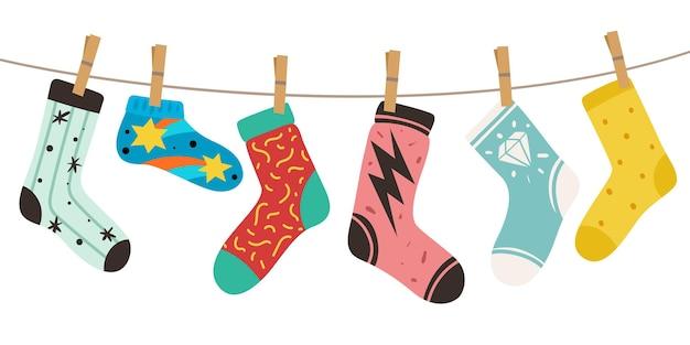 Sokken aan touw. dames, heren en kids trendy fashion sokken met kleurpatronen. stijlvol katoen en wollen lang en kort grappig schoeisel vector kleurrijk doodle modern concept van leuke, gezellige accessoires