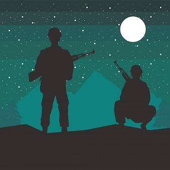 Soldaten vormen silhouetten bij nachtscène
