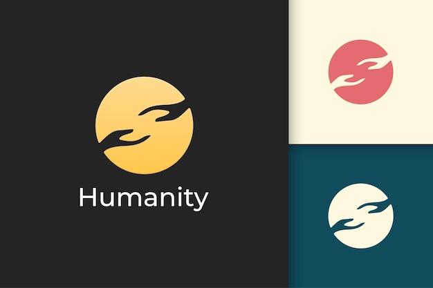 Solidariteits- of menselijkheidslogo in eenvoudige cirkel met twee handen reikend