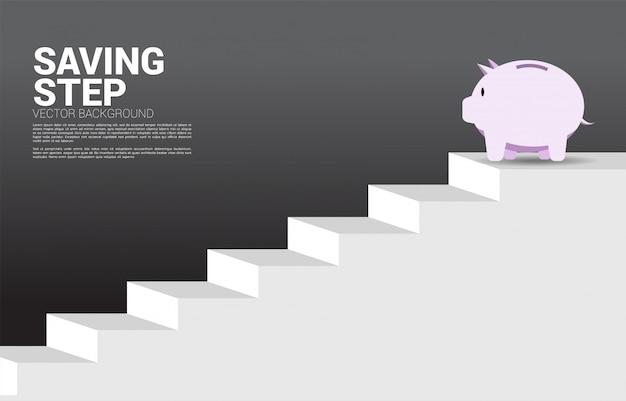 Spaarvarken bovenop trap Premium Vector