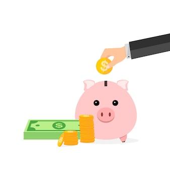Spaarvarken en hand met dollarmuntstuk op wit wordt geïsoleerd dat