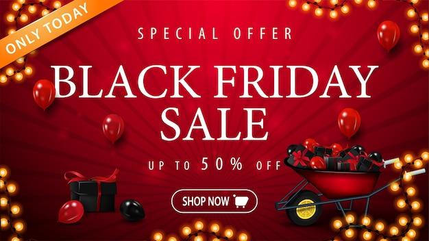 Speciale aanbieding, black friday-uitverkoop, tot 50% korting, rode vlag met kruiwagen met cadeautjes voor black friday, ballonnen in de lucht, slingerframe en knop voor aanbieding