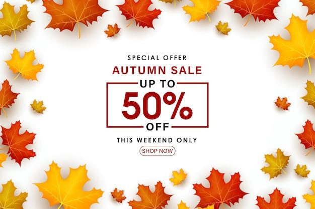 Speciale herfst verkoop bladeren verspreid over een witte achtergrond.