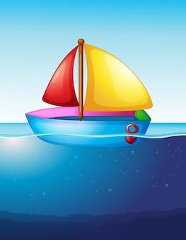 Speelgoed boot drijvend op het water