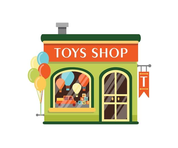 Speelgoed winkel platte vectorillustratie. kinderen winkel gebouw gevel met bord geïsoleerd op een witte achtergrond. goederen voor kinderen. kleine kiosk met houten kubussen, vouwwagen en luchtballonnen bij showcase.