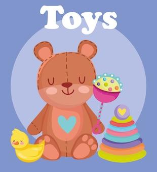 Speelgoedobject voor kleine kinderen om tekenfilm te spelen, beer met rammelaareend en piramideillustratie