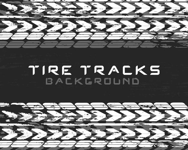 Sporen van autobanden en tracks op een zwarte achtergrond. realistische compositiesporen. motorcross, fietspad, autospoor of autoracen. bandenwissel autoservice. voertuigpictogram - minimaal symbool.