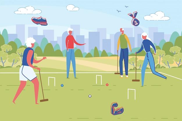 Sportieve knappe senior mensen spelen cricket.