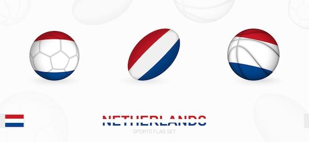 Sportpictogrammen voor voetbal, rugby en basketbal met de vlag van nederland.