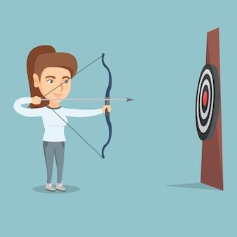 Sportvrouw die met een pijl en boog op doel richt.