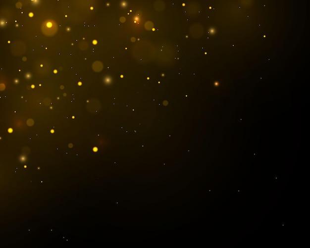 Sprankelende magische goudgele stofdeeltjes. bokeh-effect.