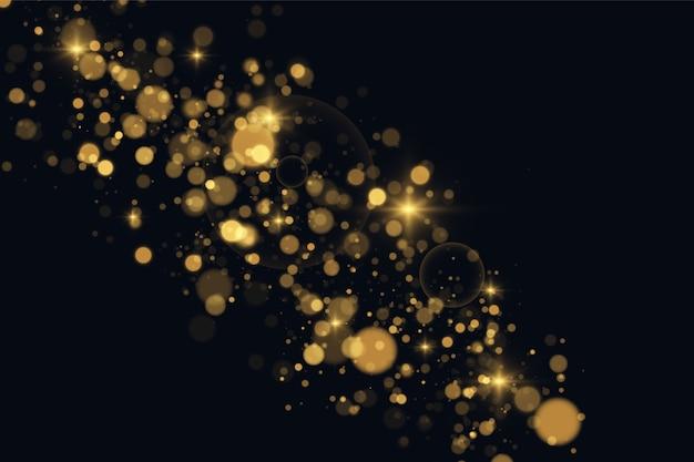 Sprankelende magische stofdeeltjes. de stofvonken en gouden sterren schijnen met speciaal licht op een zwarte transparante achtergrond. gouden glanzend lichteffect.