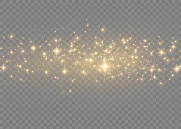Sprankelende magische stofdeeltjes. gele stofgele vonken en gouden sterren schijnen met speciaal licht. kerstmis abstract stijlvol lichteffect op een transparante achtergrond. kerstmis abstract patroon