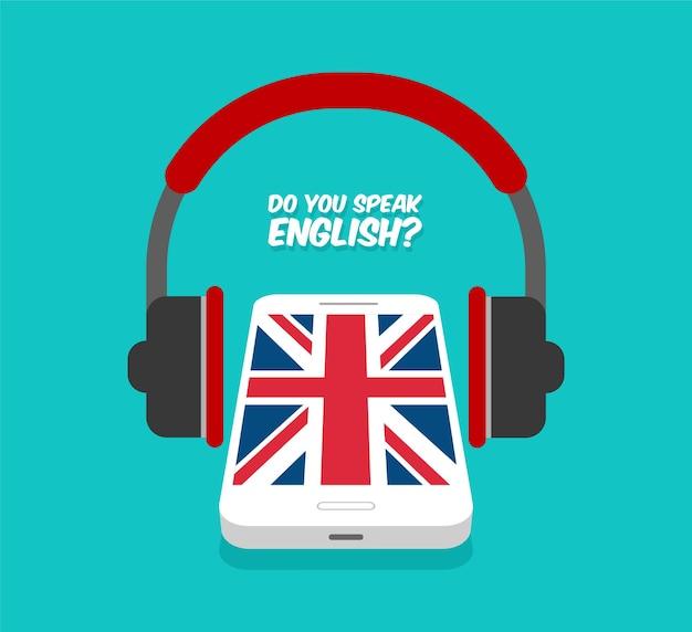 Spreek je engels concept. online leren. smartphone met koptelefoon vooraanzicht. vlag van groot-brittannië op het scherm van een telefoon.