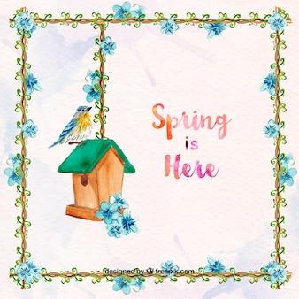 Spring achtergrond met bloemen frame en vogel met houten huis