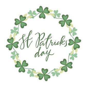 St.patrick's day belettering in een krans van klaver
