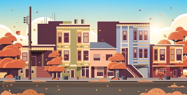 Stad gebouw huizen buitenkant moderne stad straat in herfst zonsondergang stadsgezicht