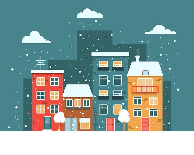 Stad met kleurrijke huizen langs de weg in de winternacht vector platte afbeelding sneeuw en sneeuwvlokken