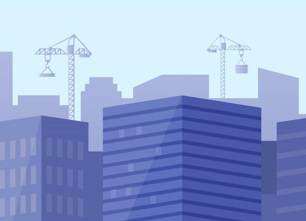 Stad met wolkenkrabbers en nieuwbouw met kranen