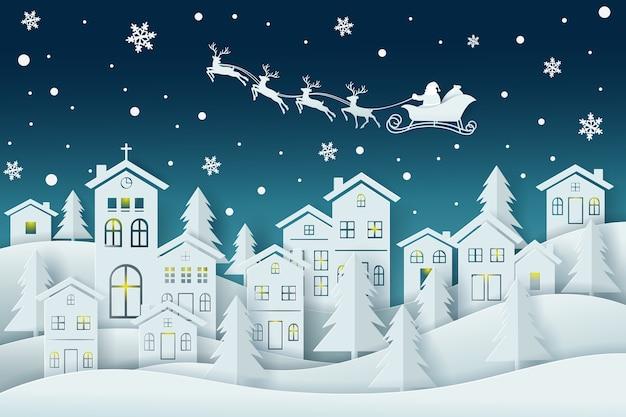 Stadsdorp met sneeuw en de kerstman die zijn slee door de lucht drijft in het winterseizoen.