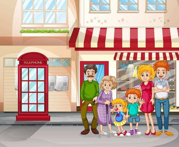 Stadsscène met gelukkige familie die voor de winkel staat