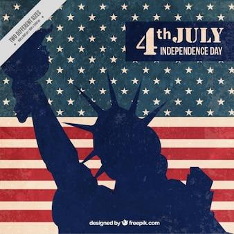 Standbeeld van vrijheid silhouet op een vintage usa vlag achtergrond