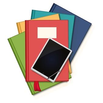Stapel kleurrijke boeken en tablet