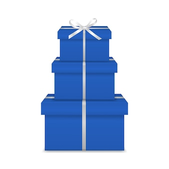 Stapel van drie realistische blauwe geschenkdozen met wit lint en boog