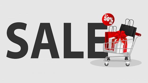 Stapel winkelen black friday-verkoop met boodschappenwagentje en zakken
