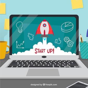 Startconcept met raket en laptop