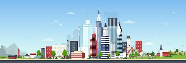 Stedelijk landschap met modern centrum of stadscentrum en kleine privé woonhuizen tegen blauwe hemel op achtergrond
