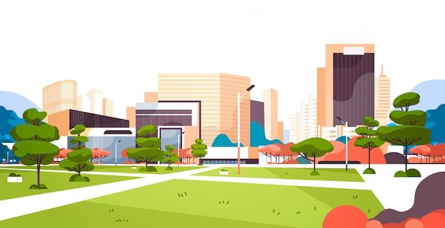 Stedelijke stadspark wolkenkrabber gebouwen bekijken moderne stadsgezicht vlak horizontaal