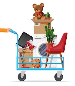 Steekwagen en pakket voor vervoer. verhuizen naar nieuw huis. familie verhuisd naar nieuw huis. papieren kartonnen dozen met verschillende huishoudelijke dingen. vectorillustratie in vlakke stijl