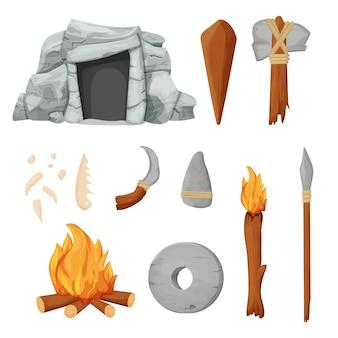 Steentijdset met barbaarse grotketting van bottengereedschap en wapen van steen en houten stokken