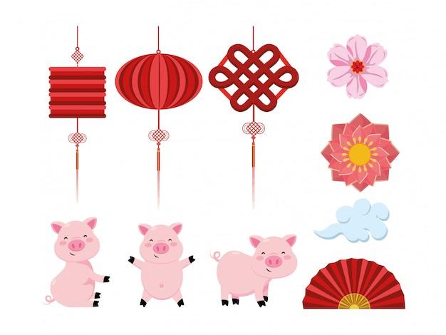 Stel chinese lampen in met bloemen en waaier met varkens