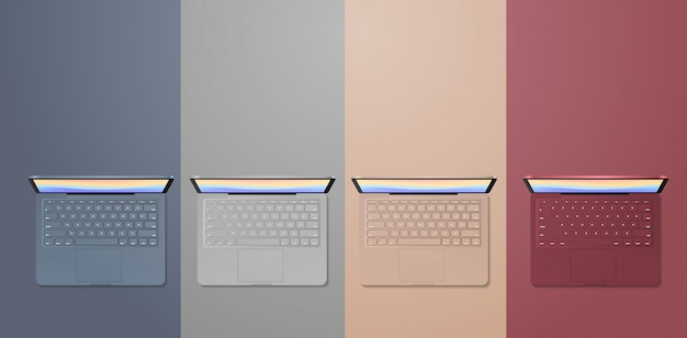 Stel gekleurde laptops realistische mockupgadgets en apparatenconcept in
